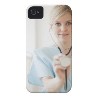 USA, New Jersey, Jersey City, Young nurse with Case-Mate iPhone 4 Case