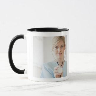 USA, New Jersey, Jersey City, Young nurse with Mug