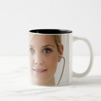 USA, New Jersey, Jersey City, Young nurse with Two-Tone Mug