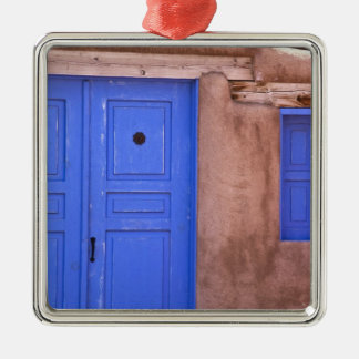 USA, New Mexico, Santa Fe. View of blue door and Silver-Colored Square Decoration