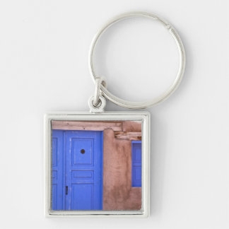 USA, New Mexico, Santa Fe. View of blue door and Silver-Colored Square Key Ring