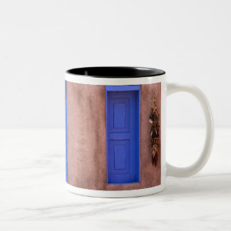 USA, New Mexico, Santa Fe. View of blue door and Two-Tone Coffee Mug