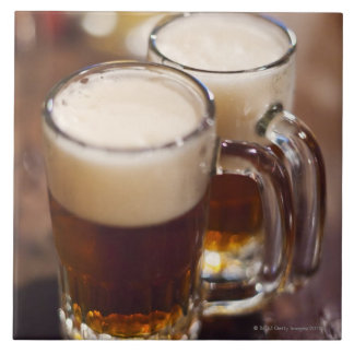 USA, New York, New York City, Two beers on bar Large Square Tile
