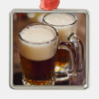 USA, New York, New York City, Two beers on bar Silver-Colored Square Decoration