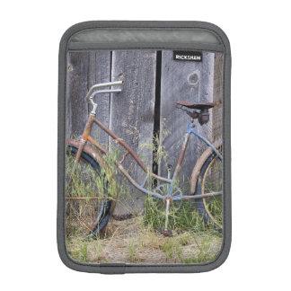 USA, Oregon, Bend. A dilapidated old bike Sleeve For iPad Mini