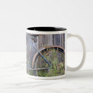 USA, Oregon, Bend. A dilapidated old bike Two-Tone Coffee Mug