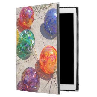 USA, Oregon. Colorful Glass Floats On Sand Dune