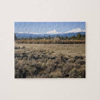 USA, Oregon, Field with snow covered Cascade Jigsaw Puzzle