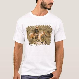 USA, Oregon, Seneca, Ponderosa Ranch. A cowboy T-Shirt