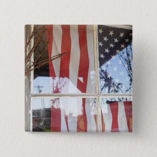 USA, Oregon, Shaniko. Flag in window next to 15 Cm Square Badge