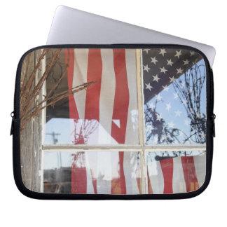 USA, Oregon, Shaniko. Flag in window next to Laptop Sleeve