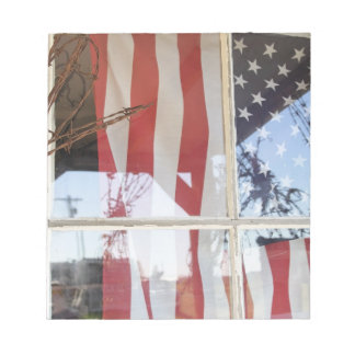 USA, Oregon, Shaniko. Flag in window next to Notepad