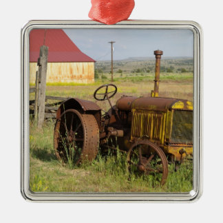 USA, Oregon, Shaniko. Rusty vintage tractor in Christmas Ornament