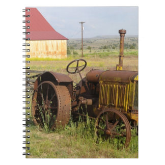 USA, Oregon, Shaniko. Rusty vintage tractor in Notebooks