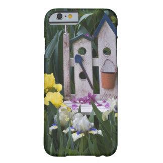 USA, Pennsylvania. Garden irises grow around Barely There iPhone 6 Case