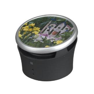 USA, Pennsylvania. Garden irises grow around Bluetooth Speaker