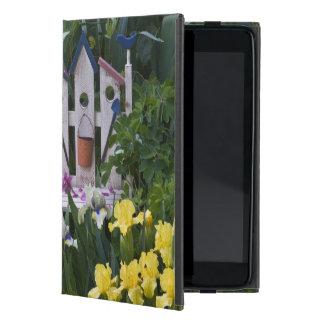 USA, Pennsylvania. Garden irises grow around Cover For iPad Mini