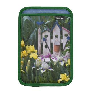 USA, Pennsylvania. Garden irises grow around iPad Mini Sleeve
