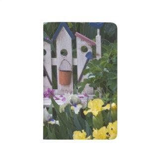 USA, Pennsylvania. Garden irises grow around Journal