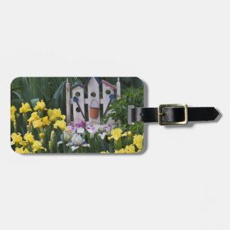 USA, Pennsylvania. Garden irises grow around Luggage Tag