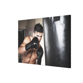 USA, Seattle, Portrait of young man boxing in Canvas Print