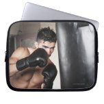 USA, Seattle, Portrait of young man boxing in Computer Sleeves