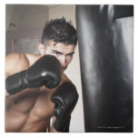 USA, Seattle, Portrait of young man boxing in Large Square Tile