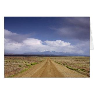 USA, Utah, Dirt road crossing landscape Card