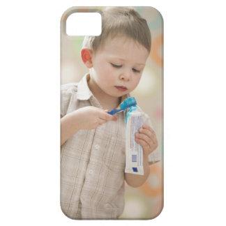 USA, Utah, Lehi, boy (2-3) brushing teeth iPhone 5 Cover