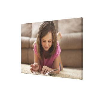 USA, Utah, Lehi, Girl (10-11) lying on rug, Canvas Print