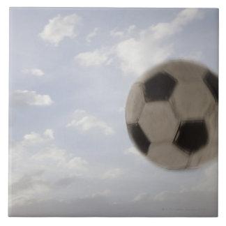 USA, Utah, Lehi, Soccer ball against sky Large Square Tile