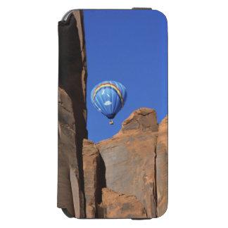USA, Utah, Monument Valley. A rainbow hot-air Incipio Watson™ iPhone 6 Wallet Case