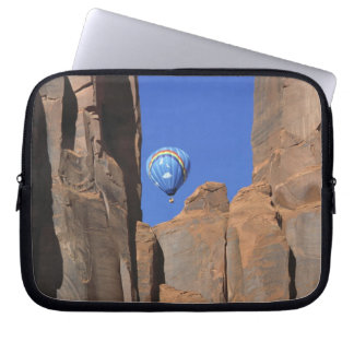 USA, Utah, Monument Valley. A rainbow hot-air Laptop Sleeve