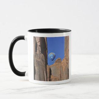 USA, Utah, Monument Valley. A rainbow hot-air Mug