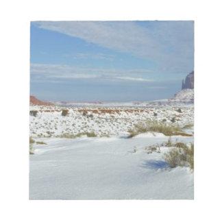 USA, Utah, Monument Valley. Sagebrush shows Notepad