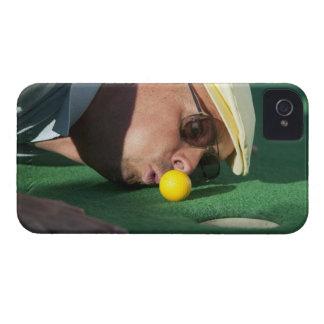 USA, Utah, Orem, Man blowing air to push golf iPhone 4 Case-Mate Case