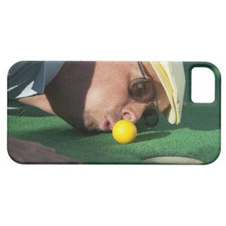 USA, Utah, Orem, Man blowing air to push golf iPhone 5 Covers
