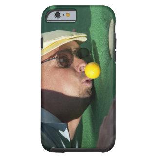 USA, Utah, Orem, Man blowing air to push golf Tough iPhone 6 Case