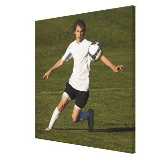 USA, Utah, Orem, teenage (14-15) boy playing Canvas Print