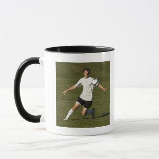 USA, Utah, Orem, teenage (14-15) boy playing Mug