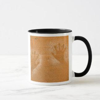 USA, Utah, Pictograph Hand-prints on sandstone, Mug