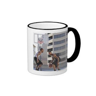 USA, Utah, Salt Lake City, two young men playing Coffee Mugs