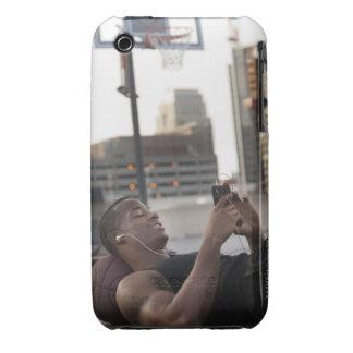 USA, Utah, Salt Lake City, Young man lying on Case-Mate iPhone 3 Case