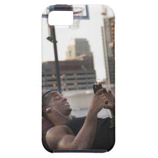 USA, Utah, Salt Lake City, Young man lying on iPhone 5 Cover