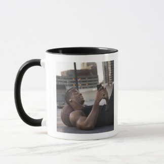 USA, Utah, Salt Lake City, Young man lying on Mug