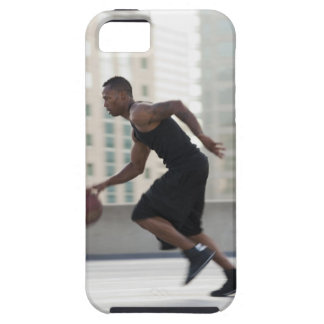 USA, Utah, Salt Lake City, Young man playing iPhone 5 Case