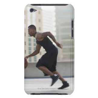 USA, Utah, Salt Lake City, Young man playing iPod Touch Case