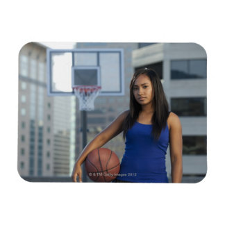 USA, Utah, Salt Lake City, young woman holding Magnet