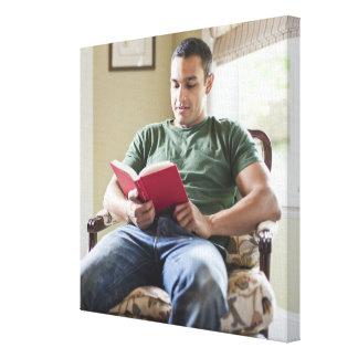 USA, Utah, Young man reading book Canvas Print