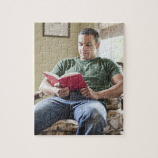 USA, Utah, Young man reading book Jigsaw Puzzle